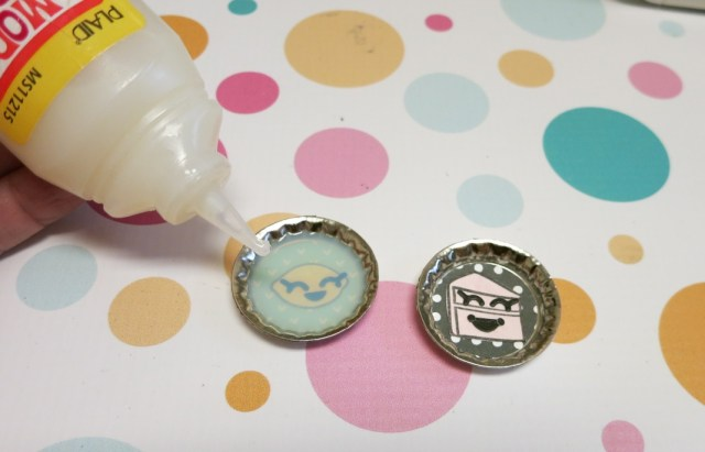 I combined a few products from Lawn Fawn with a few of my favorite Xyron products to create these cute Shopkins inspired bottlecap pendants.