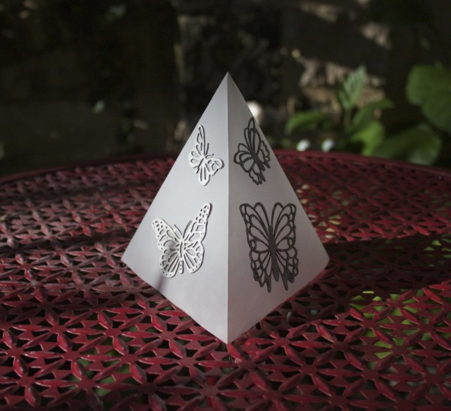Make beautiful garden party tea lights by using vellum, detailed laser cut embellishments, and the Xyron sticker maker. Quickly create beautiful decor.