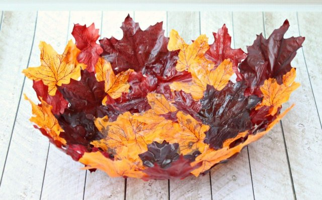 Make a DIY leaf bowl. Turn artificial leaves into a gorgeous shaped bowl. Use Mod Podge and dollar store leaves to create this stunning piece of decor!