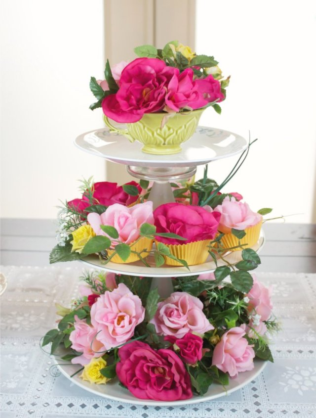 This floral centerpiece is made with thrifted items from Goodwill San Antonio, but looks high end!  Add whimsy to your tea party or garden party with this fun project.