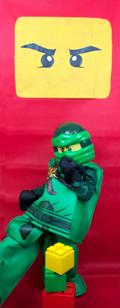Make a fun Ninjago party photo backdrop for your kids to enjoy. This quick craft is easy to make and looks great. Your LEGO fans will love this!