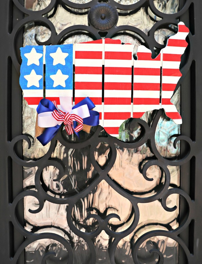 Make patriotic door decor using a cut pallet shaped like the United States. This painted piece is great for Fourth of July and other US holidays.