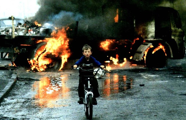 boy-riding-bicycle-out-of-fire-car-wreck-ashes-bmx-little-young