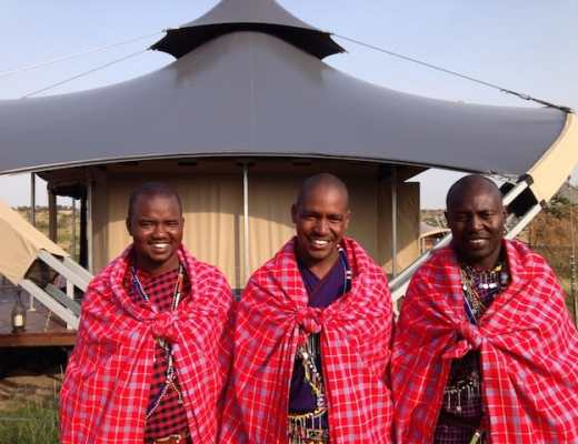 Three Maasai tribesman who work as guides at the Mahali Mzuri Safari Camp in Kenya
