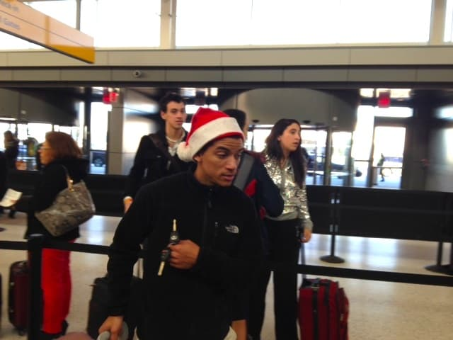No wrapped gifts but plenty of travelers with Santa hats