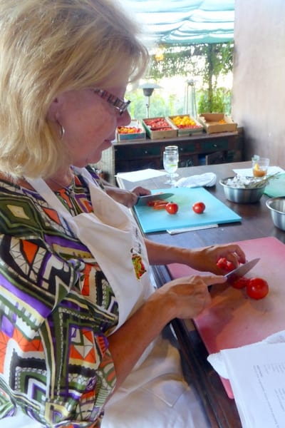 Cutting tomatoes for the salad