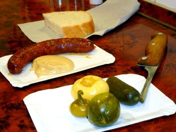 Baked sausages and pickled vegetables