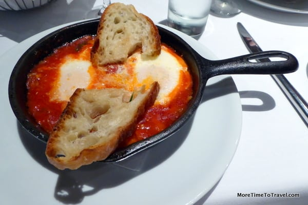 Poached eggs all'Amatriciana in tomato and guanciale sauce