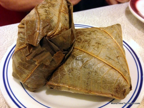 Sticky Rice In Lotus Leaf 珍珠鸡 Steamed rice mixed with chicken, wrapped in a bamboo leaf