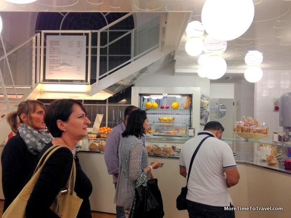 People wait to order inside