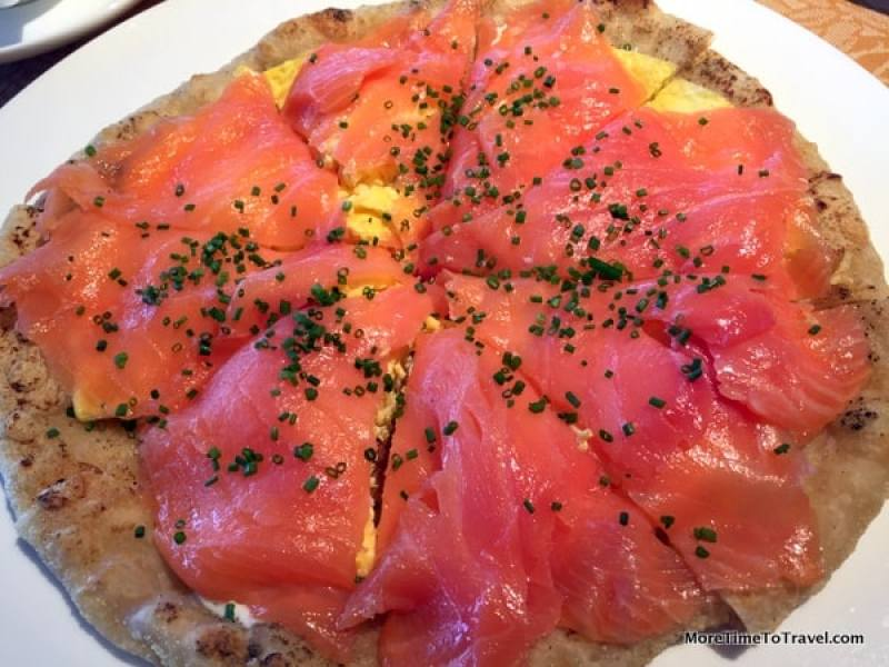 Unforgettable breakfast pizza with scrambled eggs and smoked salmon