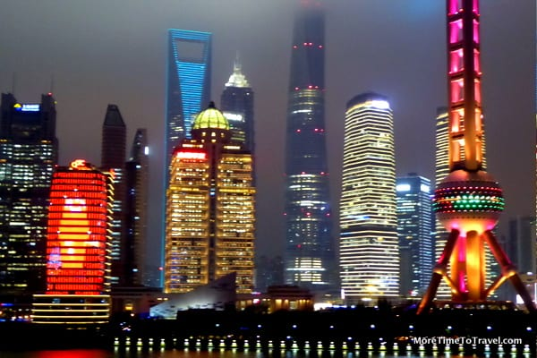 Shanghai skyline at night with the three tallest towers in the background