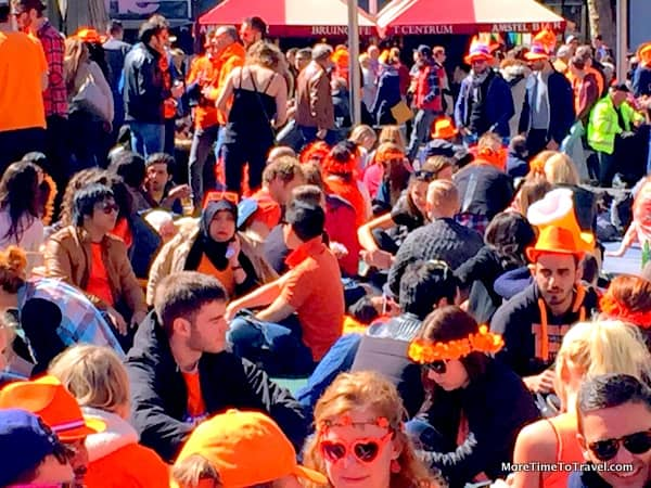 Revelers in the busy Rembrandtplein square in Amsterdam