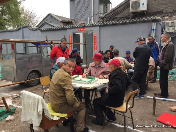 Local hutong residents playing mah jongg