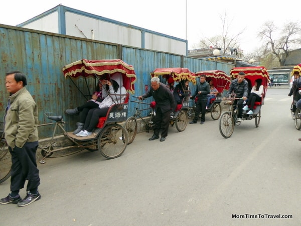 Pedicabs line up to take tourists through hutongs