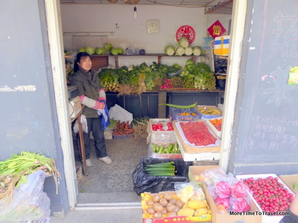 Woman selling fruit and produce from a traditional market in the hutong
