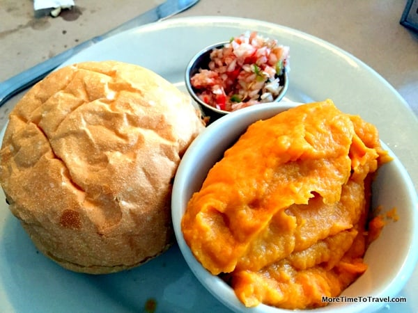 Barbecued chicken sandwich with a mashed sweet potato side