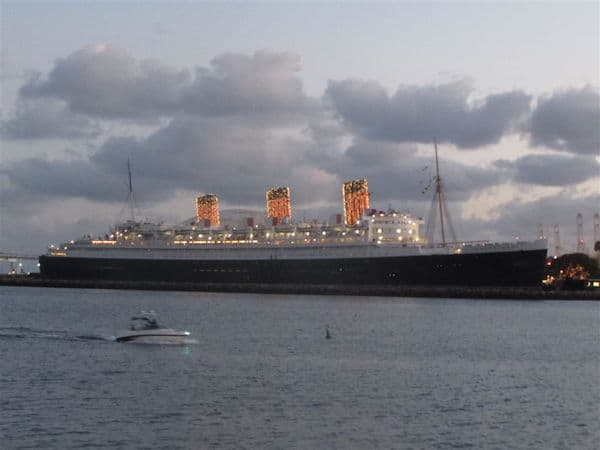 Queen Mary lights up at dusk (Credit: John and Sandra Nowlan)