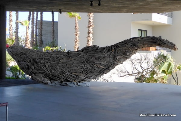 Humpback whale in outdoor lobby made from driftwood collected after the hurricane