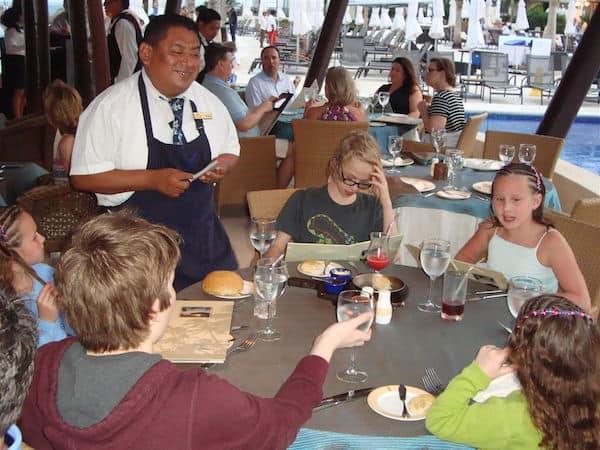 The kids ordering dinner al fresco at Dreams Riviera Cancun