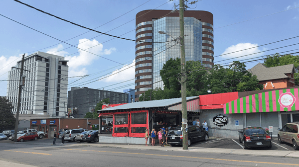 Two iconic Nashville eateries: Hattie B's and Gigi's Cupcakes. That light-gray building on the far left is the Hutton Hotel.