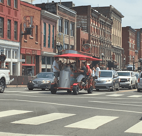 This Nashville Pedal Tavern group gave a thumbs up to The Hutton's Tesla shuttle.