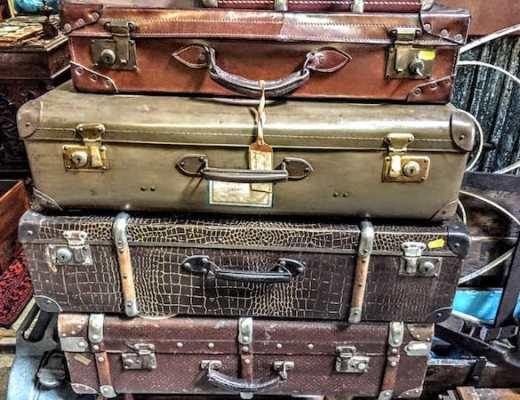 Don't overpack! (photo of vintage suitcases in Porto)