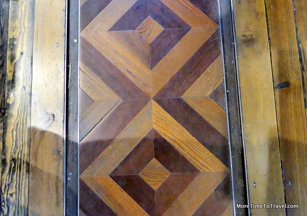 Parquet floors with tracks for a bookcart