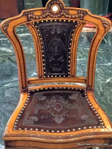 Embossed leather and wood chair