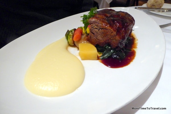 Short ribs with Cipollini onions, Thumbelina carrots and potato in a red wine veal reduction
