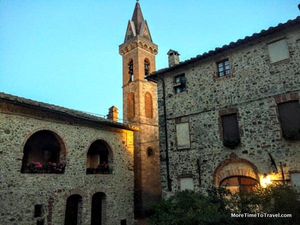 San Gusme church tower illuminated at night