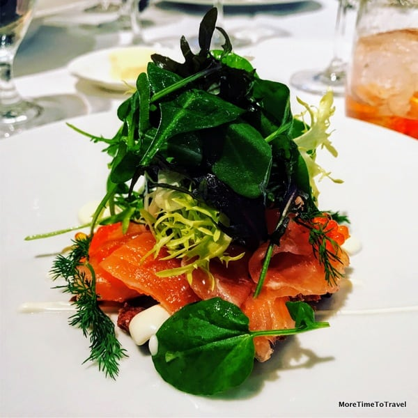 Smoked Norwegian salmon with crisp potato galette, creme fraiche, golden trout roe and micro salad