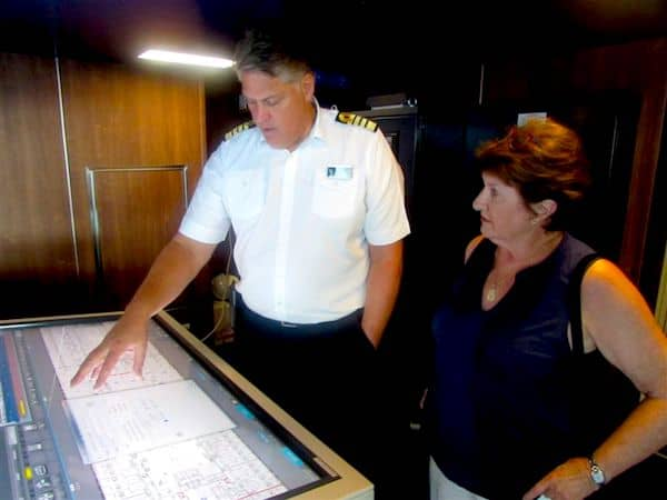 Captain of the Koningsdam explaining the ship's safety features to Sandra Nowlan