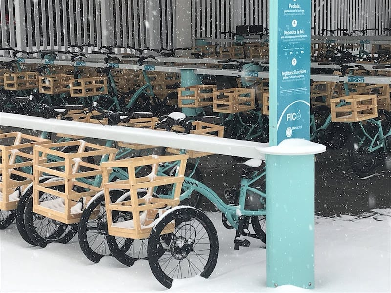 Tricycles in the snow outside of FICO Eataly World in Bolognak