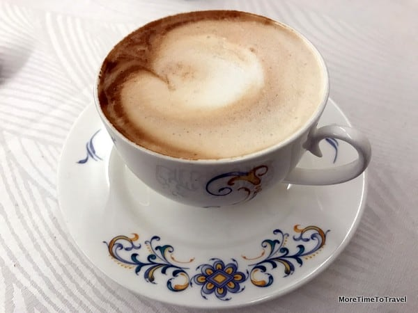Waking up to cappuccino at the Art Hotel Commercianti