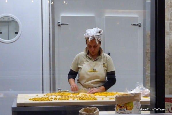 Pasta lady at a factory at FICO