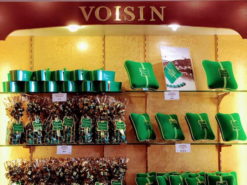 Voisin display of green cushion candies
