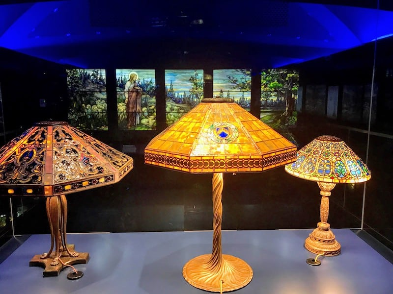 Empire-style Tiffany Lamp in front of Tiffany Window (Credit: Jerome Levine)