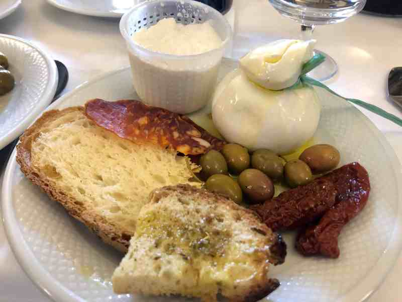 An antipasto starter at Il Terrazzino with homemade bread, cured meats and local cheeses
