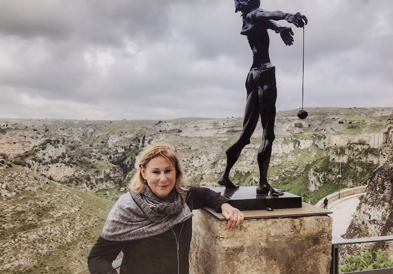 Author beside one of the 200 works by Salvatore Dali on display in Matera