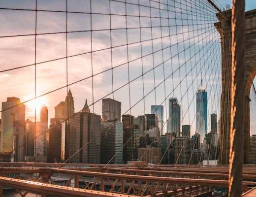 View of NYC thru Brooklyn Bridge (Credit: Unsplash)