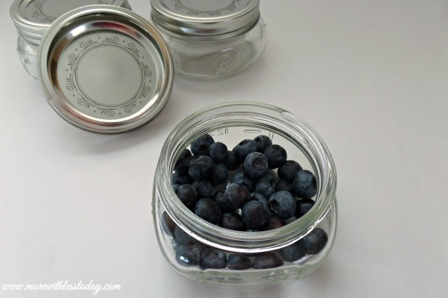 Looking for a new dessert idea? Try this easy recipe for Blueberry Dump Cake- Mini Blueberry Desserts, using mini mason jars for individual servings.