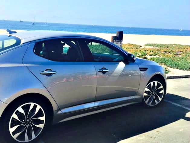 the kia optima alone at the beach