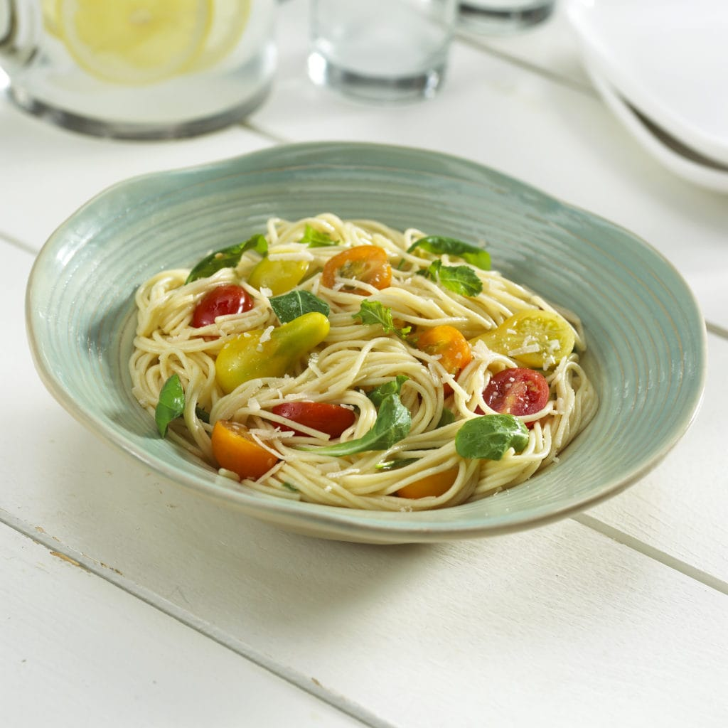 Looking for an easy summer pasta dish? This Angel Hair and Fresh Tomato Toss recipe is fast, easy and everyone loves it. It's so good hot or cold.