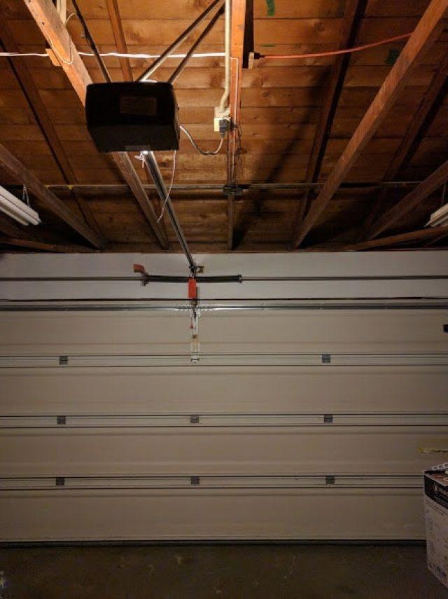 How does a smartphone garage door device work?