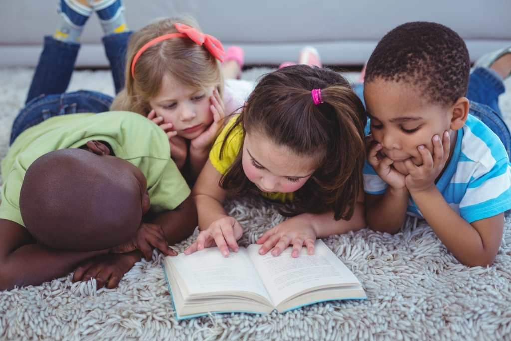 Children reading books - Free Summer Reading Programs for Kids From Barnes and Noble, Chuck E. Cheese, and More!
