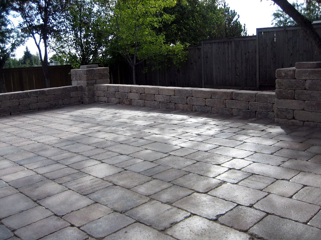 Roman Patio with Seating Wall  Morgan K Landscapes