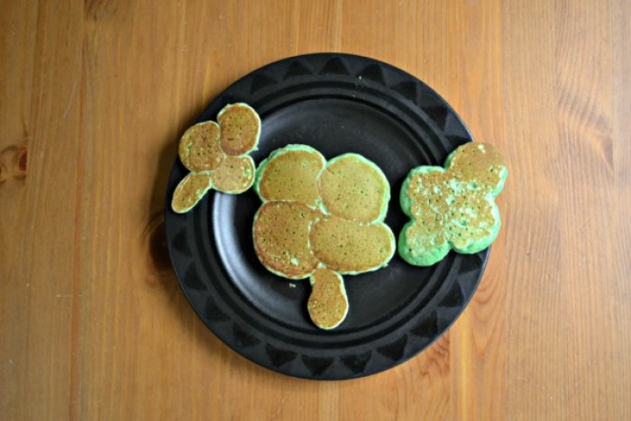 St. Patrick's Day pancakes are fun for everyone! Check out this post to learn how to make simple and festive pancakes, like these simple shamrock pancakes!