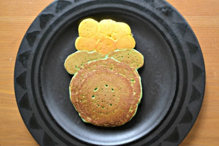 St. Patrick's Day pancakes are fun for everyone! Check out this post to learn how to make simple and festive pancakes, like these fun pot of gold pancakes!