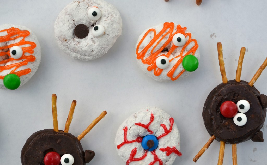 overhead short of all of the halloween donuts laid together on a white background